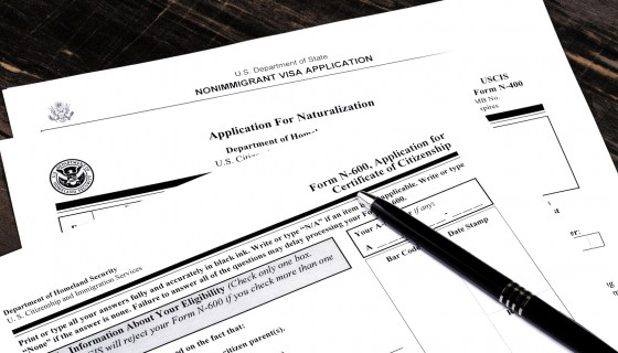 USA Immigration Applications Closeup filled out with the help of a best Chicago immigration lawyer