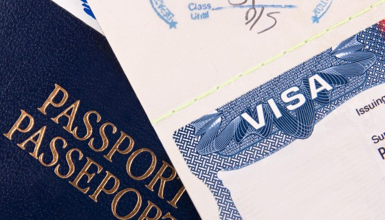 Visa and Passport on the desk of a Chicago green card attorney