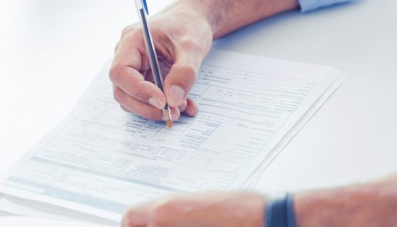 Man filling out I-9 form after speaking with a Bridgeport immigration lawyer