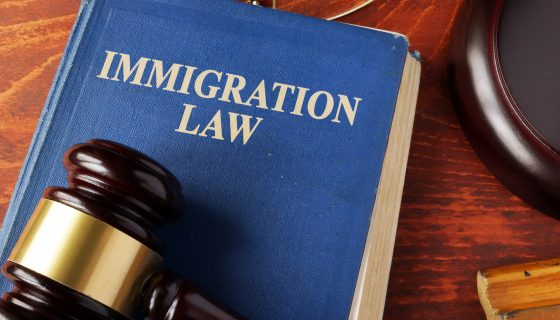 Book with title immigration law on a table for a top deportation attorney chicago