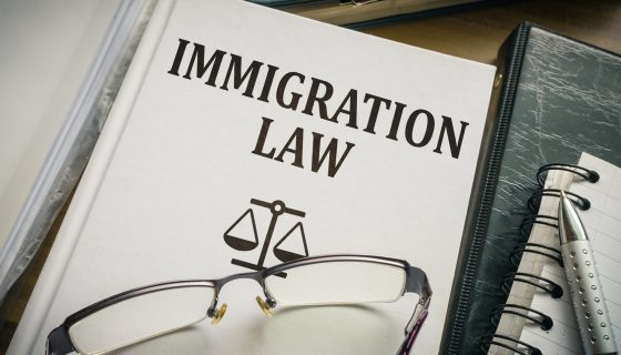 Immigration law book. Legislation and justice concept and if you need a knowledgeable immigration attorney you will find one in Chicago.